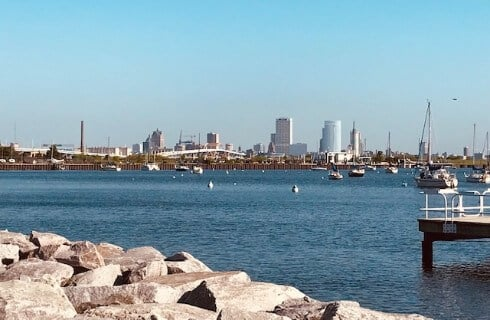 View of Milwaukee shore of Lake Michigan with boats in the harbor.
