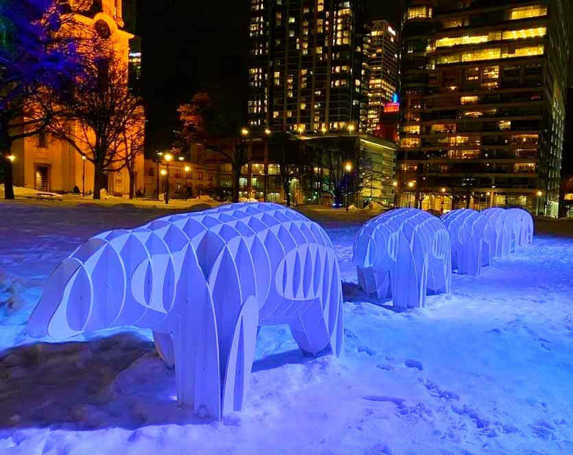 Picture of snow bear sculptures at night in blue light