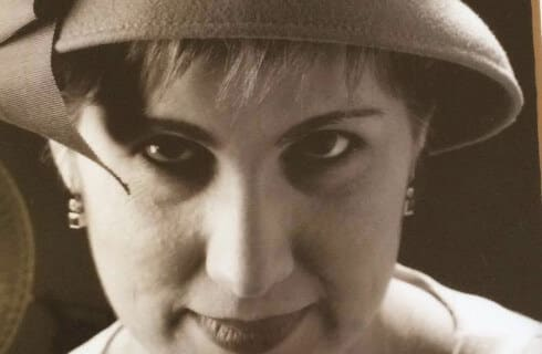 Sepia toned photo portrait of artist Tracey Thomas.